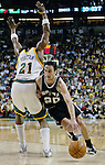 San Antonio Spurs Manu Ginobili (R) drives to the basket past Seattle SuperSonics Danny Fortson (L) in the first period of their Western Conference Semifinals Game 6 at Key Arena in Seattle, Washington on Thursday 19 May 2005.  Jim Bryant Photo. &copy;2010. All Rights Reserved.