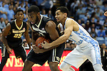 20 January 2016: Wake Forest's Codi Miller-McIntyre (left) and North Carolina's Marcus Paige (right) challenge for the ball. The University of North Carolina Tar Heels hosted the Wake Forest University Demon Deacons at the Dean E. Smith Center in Chapel Hill, North Carolina in a 2015-16 NCAA Division I Men's Basketball game. UNC won the game 83-68.