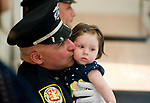WINSTED,  CT-051817JS24-Winchester Police Officer Daniel Pietrafesa, gives a kiss to his six-month old daughter Frenya Piertrafesa. after the received a Chiefs Award  during the 2nd annual Winchester Police Department's Award Ceremony Thursday in the P. Francis Hicks Room at Winchester Town Hall. <br /> Jim Shannon Republican-American