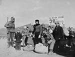 Refugees checked at the 38th Parallel: Pfc. Henry W. Graves (Ft. Worth, Texas) (Left) and Pvt. Harold J. Watson (Luling, Texas) Both of the 519th Military Police Battalion, 8th Army, check refugees for contraband before allowing them to cross the 38th Parallel bridge during the Korean War. 8 December 1950