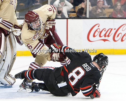 Steven Santini (BC - 6), Adam Reid (NU - 8) - The Boston College Eagles defeated the Northeastern University Huskies 4-1 (EN) on Monday, February 10, 2014, in the 2014 Beanpot Championship game at TD Garden in Boston, Massachusetts.