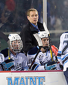 Joey Diamond (Maine - 39), Tim Whitehead (Maine - Head Coach), Brian Flynn (Maine - 10) - The University of Maine Black Bears defeated the University of New Hampshire Wildcats 5-4 in overtime on Saturday, January 7, 2012, at Fenway Park in Boston, Massachusetts.
