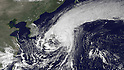 Typhoon Roke, the second typhoon to hit Japan this month, came ashore near Lake Hamana midway between Toyohashi to the west and Hamamatsu to the east near the time of this image from MTSAT-1R at 0430Z September 21, 2011. Torrential rains exceeding 3.5 inches per hour in some places and the threat of landslides and flooding have left more than a quarter of a million households without power. (Photo by National Oceanic and Atmospheric Administration/AFLO)