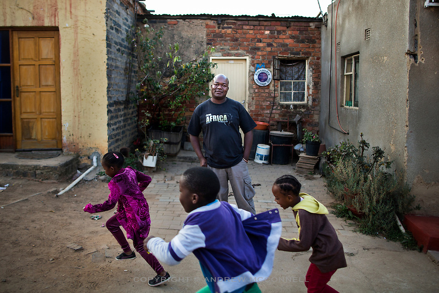 Isaac Mangena, 35, from the Limpopo Region, pictured outside the house where Nelson Mandela first lived in when he arrived in Johannesburg, in Alexandra township, South Africa.