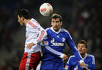 FUSSBALL   1. BUNDESLIGA    SAISON 2012/2013    14. Spieltag   Hamburger SV - FC Schalke 04                               27.11.2012 Tolgay Arslan (li, Hamburger SV) gegen Christian Fuchs (re, FC Schalke 04)