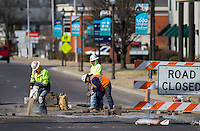 NWA Democrat-Gazette/JASON IVESTER<br /> A crew from Seven Valleys Concrete in Cassville, Mo., replace bricks Thursday, Feb. 9, 2017, at the intersection of Walnut Street and 3rd Street in downtown Rogers. The block had been closed to make repairs to a water main break.
