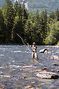 WA09131-00...WASHINGTON - Fly fishing on the Middle Fork of the Snoqualme River near North Bend. (MR# J9)