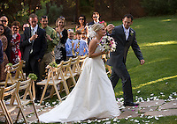 Bride and groom walk down aisle after being married in Foresthill.