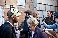Protesters - 2011<br /> <br /> London, 16/10/2011. Second day of the peaceful Occupation outside St Paul's Cathedral. In the early morning representatives of St Paul's asked police officers to leave the steps of the Cathedral and stop any attempt to evict the occupants. The tents are now numbered at around two hundred. The protesters have built a kitchen, and now dedicate their time to political meetings, discussions, creation of a library, placards and posters to show their messages: &quot;We are the 99%&quot;.