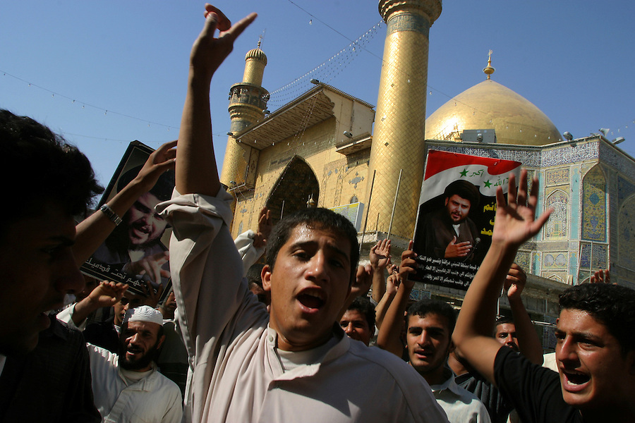 At the conclusion of the Battle of Najaf the city's Old City lies partly in ruin as supporters of Moqtada al-Sadr and his Mehdi Army celebrate within the walls of the Imam Ali Shrine on August 27, 2004.<br />