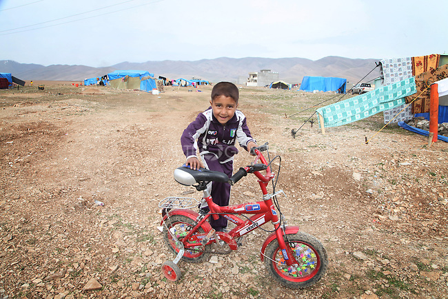 ARBAT, IRAQ: Abbas Essa, 5, from Derzor, Syria, is pictured in a refugee camp in Arbat, Iraq. ..The semi-autonomous region of Iraqi Kurdistan has accepted refugees from the conflict in Syria into several camps. Arbat lies near Sulaimaniyah in northeastern Iraq, approximately 500 kilometres from the Syrian border...Photo by Besaran Tofiq/Metrography