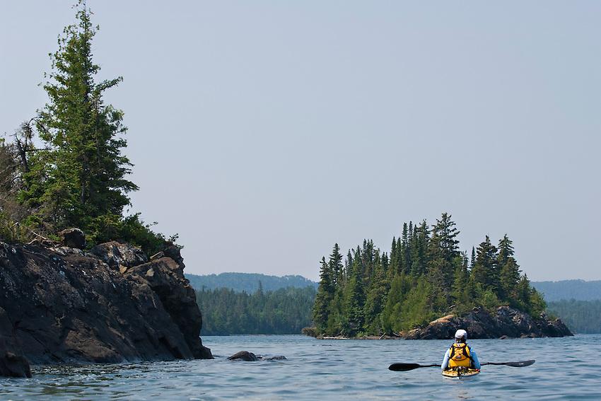 A sea kayaker on Lake Superior at Isle Royale National Park.