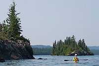 A sea kayaker on Lake Superior at Isle Royale National Park.