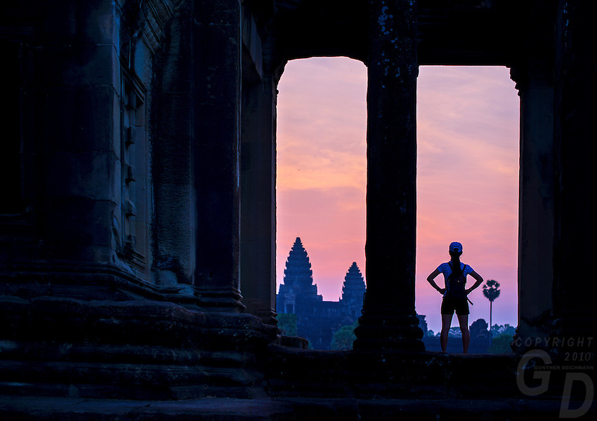 A tourist is waiting at the Library Building for the sunrise at Angkor Wat, Siem Reap, Cambodia