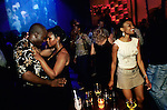 Unidentified up market black people enjoying themselves at Kilimanjaro, a trendy club, on February 14, 2004 in Melrose Arch, a suburb in Johannesburg, South Africa. A growing number of people belong to the new black elite in the country. Well educated and connected, they have risen from the poverty in the townships to a very different lifestyle, since the fall of Apartheid and the start of democracy in the country in 1994. (Photo by: Per-Anders Pettersson)..