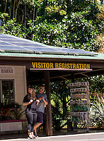Visitors at the visitor registration sign and gift shop of the Hawai'i Tropical Botanical Garden, Onomea, Big Island of Hawaiʻi.