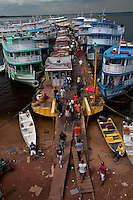 Typical boats from Amazon at Manaus harbor at the border of Negro river ( Rio Negro ), Amazonas State, Brazil.