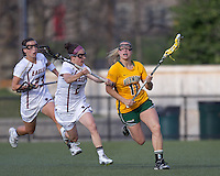 University of Vermont midfielder Karli Mackendrick (11) brings the ball forward as Boston College midfielder Cali Ceglarski (23) and Boston College midfielder Kristin Igoe (21) close. Boston College defeated University of Vermont, 15-9, at Newton Campus Field, April 4, 2012.