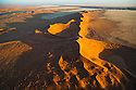 Namibia;  Namib Desert, north of Kuiseb River, aerial view, Namib-Naukluft National Park; the Kuiseb River prevents the sand dunes from moving further south