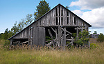 A collection of Barns that still can be seen while traveling the countryside in  the beautiful State of Wisconsin.<br />  	Door County-Barn and buildings Hwy 57 and Grove Road.