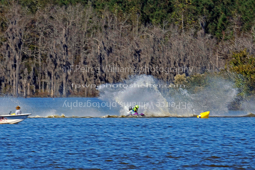 Frame 1: Erin Pittman, 6-H spins to stop in turn one, dumping her out.   (outboard hydroplane)