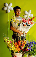 Portrait photography of Peter Herr with Herr Fresh Flowers, located inside the 7th Street Public Market in Uptown Charlotte, North Carolina. Building upon the success of Charlotte's Center City Green Market, the Seventh Street Public Market opened in 2012 to be a year-round market serving and celebrating local food artisans, entrepreneurs and local and regional farmers. Image is part of a series of photos taken of the Center City attraction.