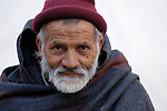 Following an October 8, 2005, earthquake, a displaced man living in a tent city outside Balakot, Pakistan. The quake measured 7.6 on the Richter scale and killed more than 74,000 people.