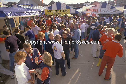 Cowes Regatta. Groves and Gutteridge yard at Cowes - the unlegislated centre of the Regatta.  The English Season published by Pavilon Books