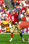 SAN FRANCISCO - CIRCA 1990's:  Steve Young of the San Francisco 49'ers in action during an NFL game at Candlestick Park in San Francisco, California.  (Photo by Ron Vesely)