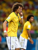 David Luiz of Brazil clears his nose of snot