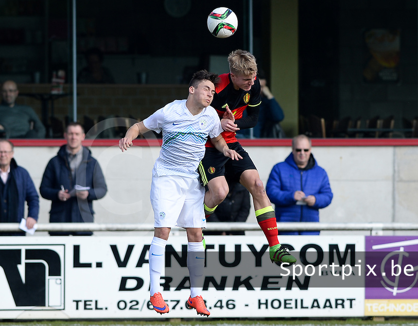 20160311 - Overijse , BELGIUM : Belgian Sebastiaan Bornauw (r) pictured in a duel with Slovenian Luka Kerin (left) during the soccer match between the under 17 teams of  Belgium and Slovenia , on the first matchday in group 8 of the UEFA Under17 Elite rounds at Begijnhofstadion in Overijse , Belgium. Friday 11th March 2016 . PHOTO DAVID CATRY