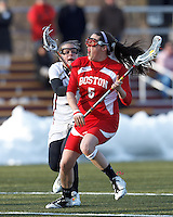 Boston University attacker Elizabeth Morse (5) on the attack as Boston College defender Ali Meagher (9) defends..Boston College (white) defeated Boston University (red), 12-9, on the Newton Campus Lacrosse Field at Boston College, on March 20, 2013.