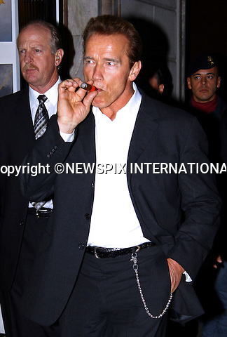 "ARNOLD SCHWARZENEGGER.puffs away on his cigar in public while visiting Milan_18/11/2009.Mandatory Credit Photo: ©NEWSPIX INTERNATIONAL..**ALL FEES PAYABLE TO: ""NEWSPIX INTERNATIONAL""**..IMMEDIATE CONFIRMATION OF USAGE REQUIRED:.Newspix International, 31 Chinnery Hill, Bishop's Stortford, ENGLAND CM23 3PS.Tel:+441279 324672  ; Fax: +441279656877.Mobile:  07775681153.e-mail: info@newspixinternational.co.uk"