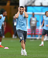 Luis Suarez of Uruguay reacts as he trains in the Arena Corinthians, Sao Paulo ahead of his sides Group D crunch fixture vs England tomorrow