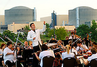 "Event photography of the Charlotte Symphony performing in a free outdoor concert June 17, 2012 at Duke Energy's McGuire Nuclear Station EnergyExplorium in Cornelius, NC. The symphony orchestra performed a ""musical travels"" program. Albert George Schram conducted."