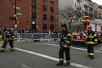 NYC firefighters arrive to the scene where a powerful explosion knocked two residential buildings in East Harlem killing 2 people and injuring at least 22 others in New York. March 12, 2014. Photo by Eduardo Munoz Alvarez/VIEW