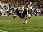 Nov. 3, 2012; Quarterback Everett Golson dives into the end zone to tie the game in a two-point conversion against Pittsburgh in the fourth quarter. Photo by Barbara Johnston/University of Notre Dame