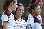 09 September 2011: Texas A&M's Allie Bailey (center) with Annie Kunz (left) and Beth West (10). The Duke University Blue Devils defeated the Texas A&M Aggies 7-2 at Koskinen Stadium in Durham, North Carolina in an NCAA Division I Women's Soccer game.