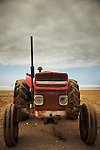 Quirky image of a red tractor on a beach