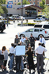 Carson City Sheriff Ken Furlong, center, holds a press conference outside the IHOP restaurant in Carson City, Nev., on Tuesday, Sept. 6, 2011, after a gunman opened fire with an AK-47, killing three and injuring six. (AP Photo/Cathleen Allison)