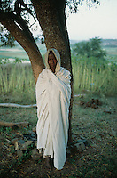Eritrea. Southern Debud Zone. Maiado.  Small village in the country. Old woman dressed in white cotton loinclothes pray during the religious service (just after sunrise) in the orthodox church.  © 2002 Didier Ruef