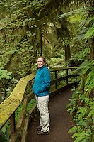 Lori stands along the Rain Forest Nature Trail in the Quinault Rain Forest on July 20, 2016. The termperate rain forest areas on the Olympic Peninsula get upwards of 200 inches of rain per year, making it very lush, moss-covered, and green.