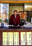 Motohiro Watanabe, 50, who has persuaded dozens of people not suicide, stands at the counter window of his store at an entrance to Aokigahara Jukai, better known as the Mt. Fuji suicide forest, in Yamanashi Prefecture, west of Tokyo, Japan on 04 Nov. 2009. ..