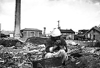 An aged Korean woman pauses in her search for salvageable materials among the ruins of Seoul, Korea.  November 1, 1950.  Capt. C. W. Huff. (Army)<br /> NARA FILE #:  111-SC-351700<br /> WAR &amp; CONFLICT BOOK #:  1504