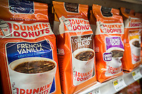 A display of Dunkin Donuts coffee on a supermarket shelf in New York on Saturday, August 29, 2015. J.M. Smucker Co. reported coffee business rose 12 percent for the first time in 11 quarters bringing up the company's overall results.  Smucker makes Folgers and the Dunkin Donuts brand coffees. (© Richard B. Levine)