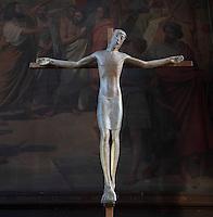 Christ crucified, modern sculpture,  Eglise Saint-Sulpice (St Sulpitius' Church), c.1646-1745, late Baroque church on the Left Bank, Paris, France. Picture by Manuel Cohen