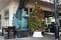Balinese statue and Christmas tree.<br /> Sanur, Bali