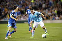 Samir Nasri (8) Manchester City watched by Yossi Benayoun..Manchester City defeated Chelsea 4-3 in an international friendly at Busch Stadium, St Louis, Missouri.