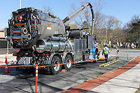 A Con Edison vacuum truck crew works on a street in White Plains, New York.