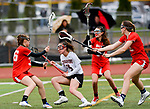 CHESHIRE, CT-042517JS14- Cheshire's Kaitlyn D'Andrea  (15) slips through a trip of Branford defenders on her way to the net during their game Tuesday Cheshire High School. <br /> Jim Shannon Republican-American